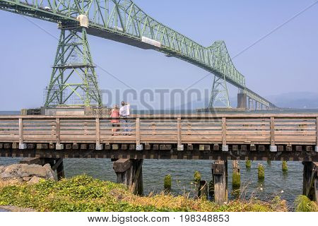 Visitors enkoying a day in Astoria Oregon.