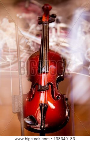 Miniature classical violin musical instrument. No people