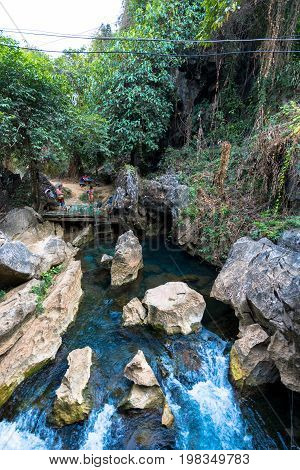 VANG VIENG LAOS - MARCH 14 2017: Vertical picture of Blue Lagoon at Tham Chang Cave close to the city of Vang Vieng Laos.