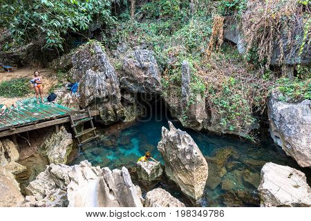 VANG VIENG LAOS - MARCH 14 2017: Horizontal picture of Blue Lagoon at Tham Chang Cave close to the city of Vang Vieng Laos.
