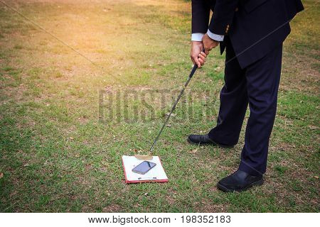 Abstract business man preparing to shoot clipboard and smartphone in reduce stress at work. business concept relax and with out work.