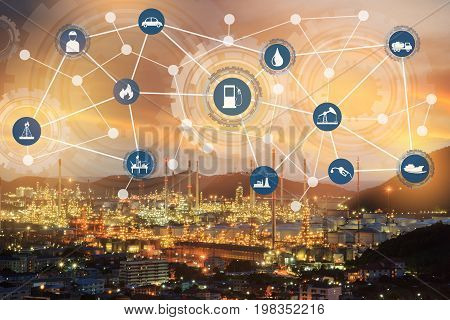 Light oil refinery at twilight with physical system icons diagram on industrial factory. Industry on technology 4.0 concept support with double exposure.