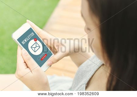 Woman hand holding mobile phone and use email application Subscribe newsletter concept