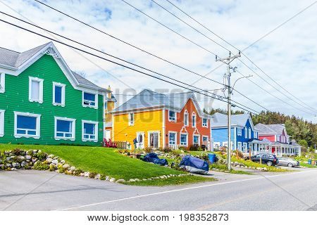 Sainte-Flavie Canada - June 5 2017: Colorful beach houses in Gaspesie region of Quebec by Saint Lawrence river during day