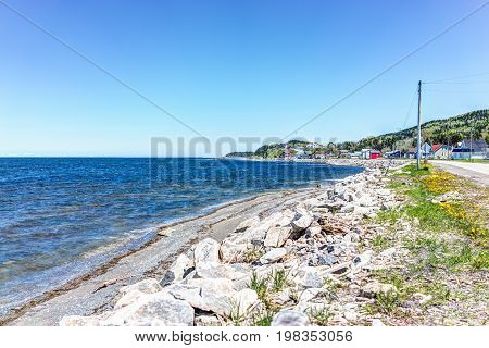 Cityscape Of Grosses-roches Village Town And Saint-lawrence River During Day With Colorful Houses