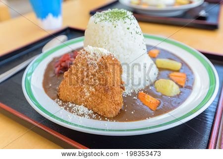 Traditional Japanese Curry Omelet Rice With Beef And Batter-frie