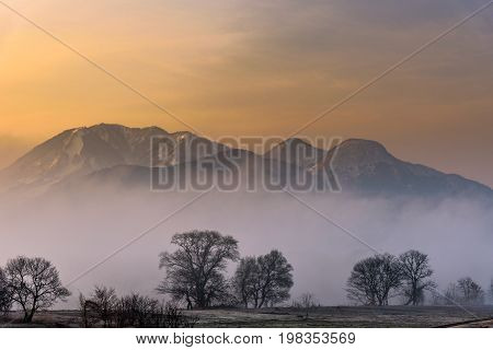 Scene Of Mountain With Snow And Fog During The Sunrise