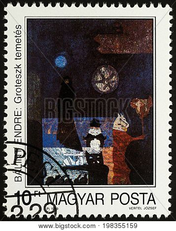 Moscow Russia - August 05 2017: A stamp printed in Hungary shows painting Grotesque Funeral by Endre Balint series