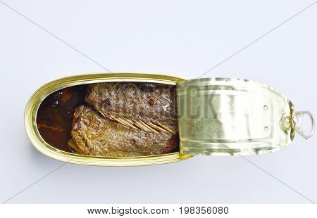 salty fried fish in tin canned opened on white background poster