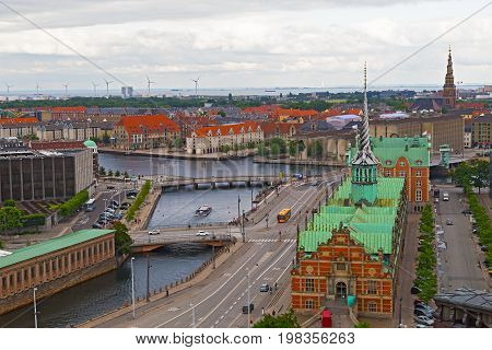 Waterfront city buildings along the canal in Copenhagen Denmark. Copenhagen city panorama in summer Denmark.