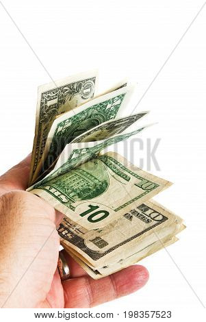 A hand holding a small amount of american money isolated against a pure white background.