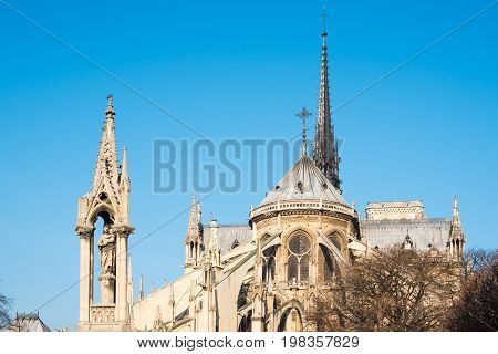 Top of Notre-Dame Cathedral against blue sky in Paris, France
