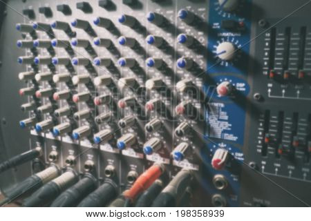 Blur image of Sound system control panel and sound mixer control for background. vintage tone