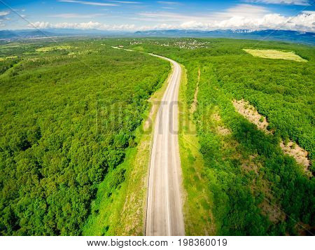Aerial shot of road forest and sky
