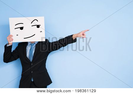 businessman take look somewhere billboard and show something on blue background