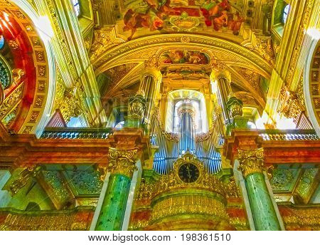 Vienna, Austria - January 02, 2015: The interior of the beautiful Jesuit Church or Jesuitenkirche, a two-floor, double-tower church in Vienna, Austria, influenced by early Baroque principles but remodeled by in 1703-1705 at Vienna, Austria