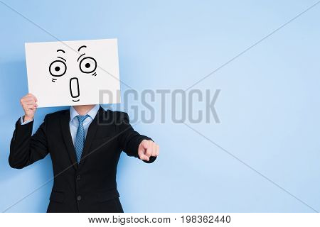 businessman take surprise billboard and show something on blue background
