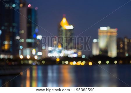 Blurred bokeh city office building light night view abstract background