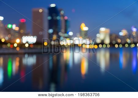 Twilight blurred bokeh city downtown with reflection abstract background