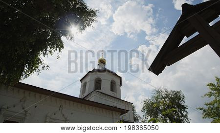 Wooden orthodox Cross and dome of church - slider shot, wide angle