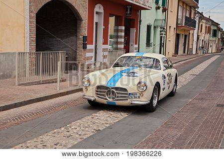 GATTEO, FC, ITALY - MAY 19: driver and co-driver on a vintage racing car Maserati A6G 54 Berlinetta Zagato (1955) in historical classic car race Mille Miglia, on May 19, 2017 in Gatteo, FC, Italy
