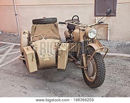 FAENZA, ITALY - NOVEMBER 2: old BMW R75 750 cc World War II era motorcycle with sidecar made in Germany in military vehicle rally during the festival