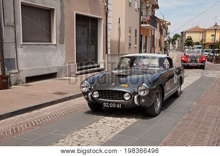 GATTEO, FC, ITALY - MAY 19: driver and co-driver on a sports car Ferrari 250 GT Europa (1955) in historical classic car race Mille Miglia, on May 19, 2017 in Gatteo, FC, Italy