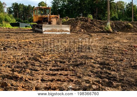 The excavator cleared the land leaving traces . Selective focus. Copy space. A horizontal frame.