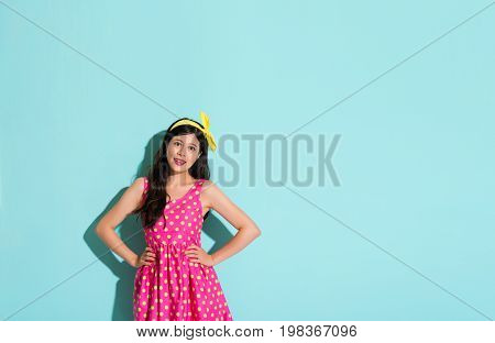 Woman In A Cute Dress And Wearing A Yellow Bow Tie