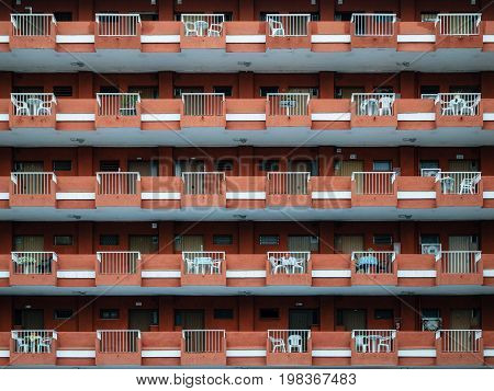 Texture of multistorey apartment house wall with balconies and windows in Puerto de la Cruz Tenerife Canary islands Spain
