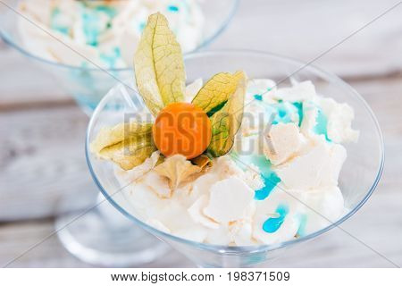 Pavlova in martini glass with syrup blue curacao.