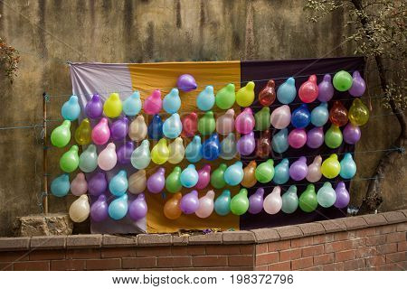 Balloons As Targets On The Wall