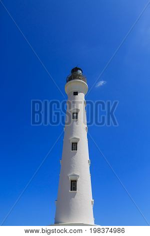 A Newly refinished lighthouse in Aruba under blue sky