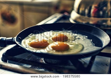 Eggs fry in a frying pan, morning