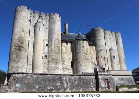 NIORT, FRANCE, JULY 16 2017: The imposing Donjon (Old Keep) or Chateau of Niort  a medieval castle and tourist attraction in the French town of Niort in the Deux-Sèvres region.