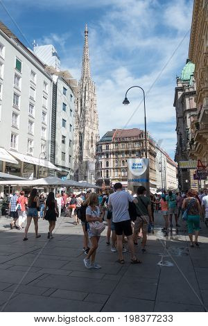 Vienna Austria - July 31 2017: Stephansplatz in Central Vienna with famous St. Stephens Cathedral. Tourists are walking around and enjoy the points of interest on a sunny day