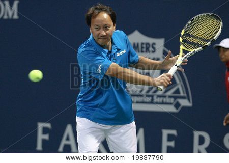 LOS ANGELES, CA. - JULY 24: John Lovitz and Jim Courier play a charity match against Gavin Rossdale and Michael Chang (pictured) at the Farmers Classic on July 24 2010 in Los Angeles.