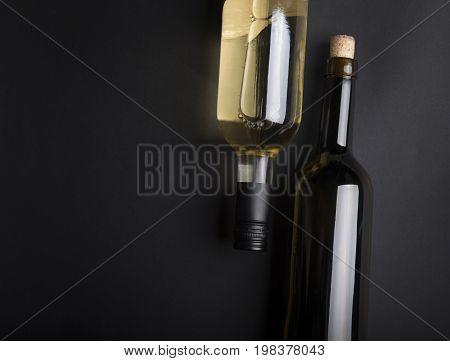 Row of vintage wine bottles in a wine cellar.