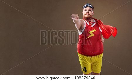 Fat funny man in a superhero costume.