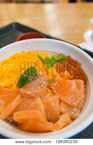 salmon rice bowl with egg and roe traditional famous Japanese food