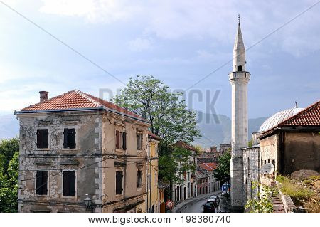 Street with minaret tower in Mostar, Bosnia and Herzegovina