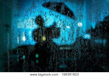 Rain drop on the glass with refection.