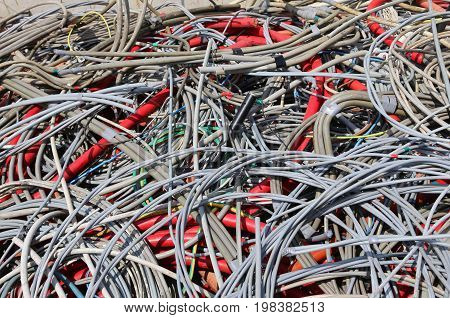 Background Of Used Electrical Cables In A Dump