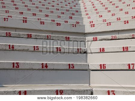 Numbers On The Stadium Bleachers To Indicate A Seat At Events