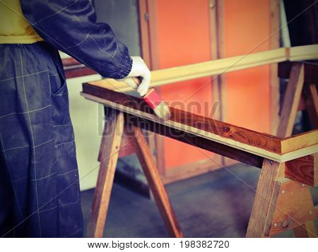 Worker Paints The  Workshop