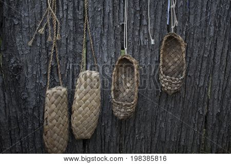 The old bast shoes hang on the fence and dryed