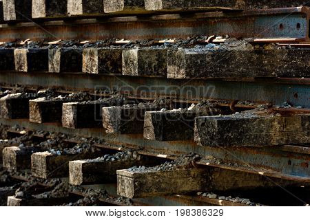 Wooden sleepers in railway station stock. Background.