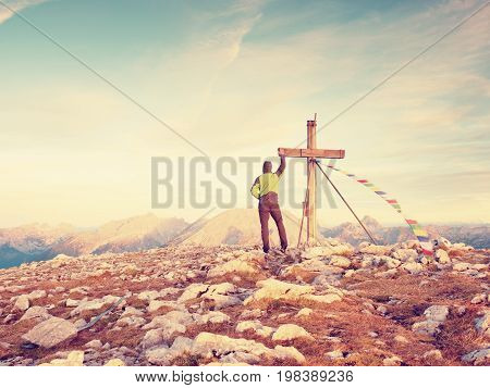 Man Walk Along The Wooden Cross At A Mountain Peak Built To Alps Victiims. Cross On Top