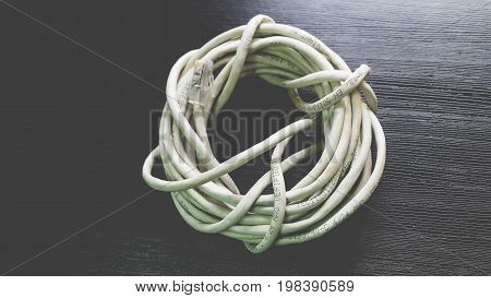 Rolled White Network Cables on Black Background
