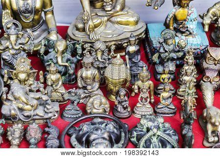hindu god idols displayed outside of a shop